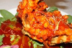 Pescados cocidos en salsa marrón Foto de archivo libre de regalías