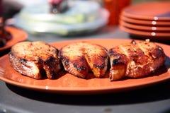 Pescados cocinados sobre el carbón de leña Fotografía de archivo libre de regalías