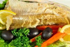 Pescados con las verduras y las hierbas Imagen de archivo