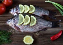 Pescados con un limón Imagen de archivo libre de regalías