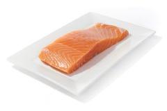 Pescados de color salmón en plato Foto de archivo