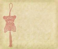 Pescados de la suerte en el fondo de papel Imagen de archivo