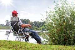 Pescados del pescador en el río Fotografía de archivo