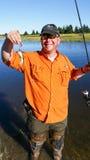 Pescados divertidos sonrientes del hombre pequeños Imagen de archivo libre de regalías