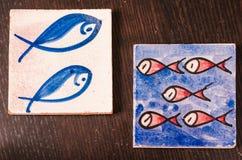 Pescados en la tabla Fotografía de archivo