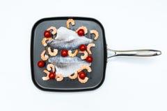 pescados en una cacerola Fotografía de archivo