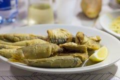 Pescados fritos con el limón Fotos de archivo libres de regalías