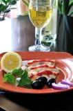Pescados fritos con el vino Fotos de archivo