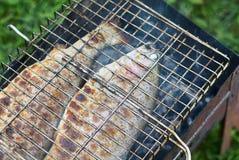 Pescados fritos en la parrilla Fotografía de archivo libre de regalías