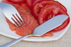 Pescados rojos y tomates maduros Imágenes de archivo libres de regalías