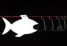 Pescados y anzuelos parecidos al papel Foto de archivo