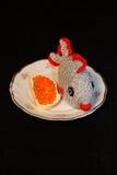 Pescados y caviar en una placa Imagen de archivo