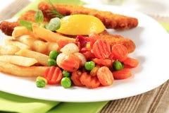 Pescados y patatas fritas fritos Fotos de archivo