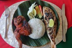 Pescados y pollo asados a la parrilla Balinese Imagen de archivo libre de regalías