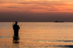 Pescando al tramonto Immagini Stock Libere da Diritti