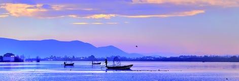 Pescando al tramonto Immagine Stock