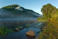 Pescando all'alba. Immagine Stock
