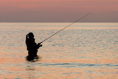 Pescando all'alba Immagine Stock