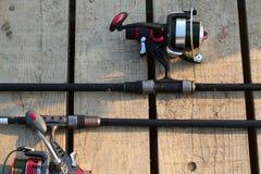 Pescando as hastes e os carretéis de giro fotografia de stock royalty free