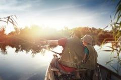 Pescando dal lago è la nostra passione comune immagini stock libere da diritti