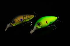 Pescando i richiami isolati su fondo nero Immagine Stock