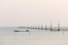 Pescando su un lago Fotografia Stock