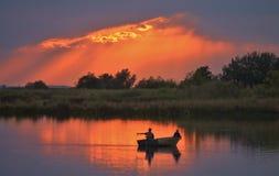 Pescando su una sera calma Fotografia Stock Libera da Diritti