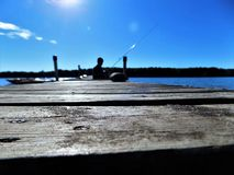Pescando sul bacino Fotografia Stock