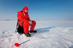 Pescando sul ghiaccio Immagini Stock