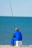 Pescando sulla spiaggia Fotografie Stock