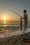Pescando sulla spiaggia Immagine Stock Libera da Diritti