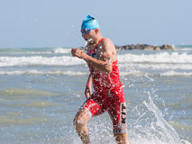 Arrival of the first athletes at the end of the swimming test at Ironman 70.3 in Pescara Stock Images