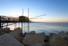 Pescara. Italy, Pescara, the traditional fishing equipment colled Trabocco, on the breakwater of the harbor stock image