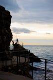 Pescatore al tramonto Immagini Stock Libere da Diritti