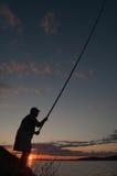 Pescatore al tramonto Immagine Stock