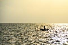 Pescatore & barca fotografia stock libera da diritti