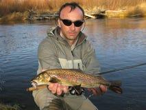 Pescatore con i pesci Immagini Stock