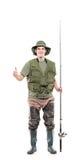 Pescatore con i pollici in su immagini stock