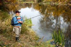 Pescatore con la filatura. Immagine Stock Libera da Diritti