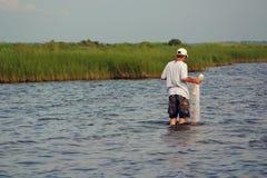 Pescatore con rete Immagini Stock