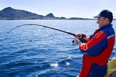 Pescatore con una filatura Fotografie Stock