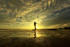 Pescatore della siluetta immagine stock