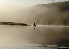 Pescatore di primo mattino Immagini Stock
