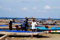 Pescatore e barche Fotografie Stock