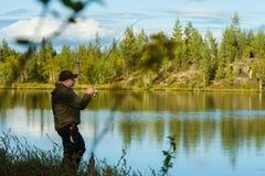 Pescatore e paesaggio Fotografia Stock Libera da Diritti