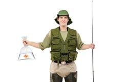 Pescatore felice che tiene un sacchetto di plastica con i pesci Fotografia Stock Libera da Diritti