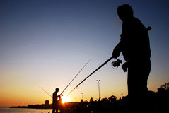 Pescatore Fishing Rod Silhouette Immagine Stock
