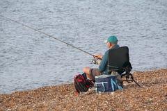 Pescatore messo con la barretta fotografie stock libere da diritti