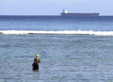 Pescatore nel mare Fotografia Stock Libera da Diritti