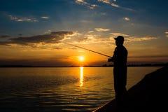 Pescatore nel tramonto Immagini Stock